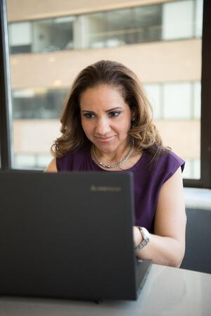 woman using her all-in-one property management system